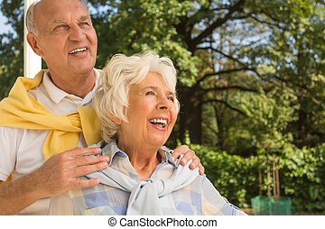 Older man with his wife