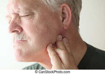 Older man with painful jaw - senior man suffering from pain...