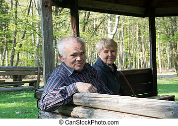 Older people sitting in the arbor