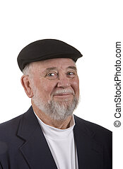An older man with beard and mustache in hat smiling against white background