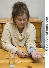 high blood pressure - older woman has high blood pressure