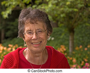 Older Woman Laughing In Garden