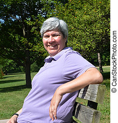 Older woman on bench smiling