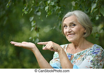Older woman pointing