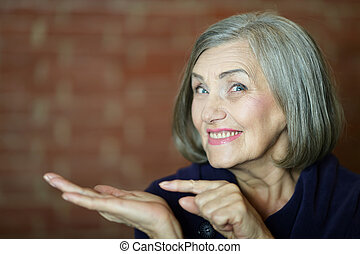 Older woman pointing - Portrait of a older woman pointing ...