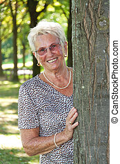 Older woman (senior citizen) is a tree