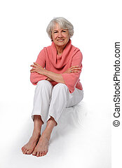 Older Woman Sitting - Beautiful older woman sitting and...