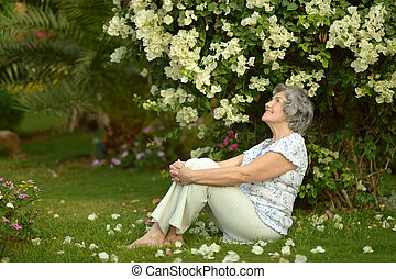 Older woman sitting with flowers