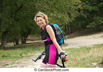 Older woman smiling with bicycle