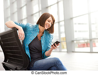 Older woman smiling with cell phone