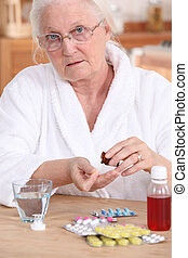 Older woman taking medicine