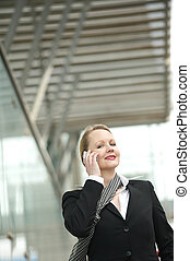 Older woman talking on the phone outdoors