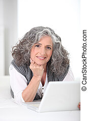 Older woman using a laptop computer
