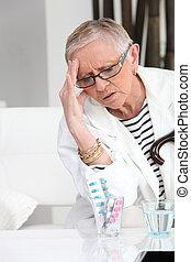 Older woman with a headache