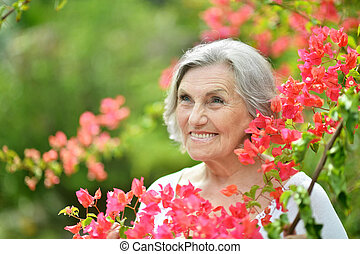 Older woman with red flowers