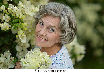 Older woman with white flowers