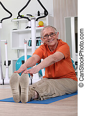 Older woman working out on a gym mat