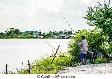 oldman angler fishing on the river
