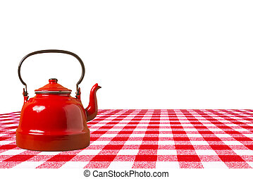 Oldred teapot on a table isolated.