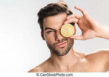 olhar, homem, segurando, foto, limão, câmera, bonito, metade...