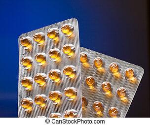 olio, pillole, pacco