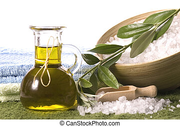 olive bath items. fresh branch, salt, oil, towels. spa