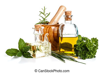 Olive oil and herbs on white background