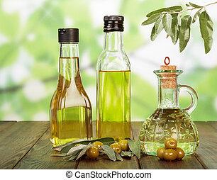 Olive oil and olives - Olive oil in bottles and olives on ...