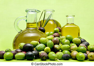 olive oil and olives on green background
