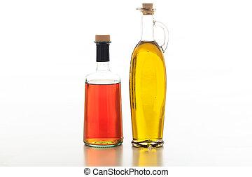 Olive oil and vinegar on white background