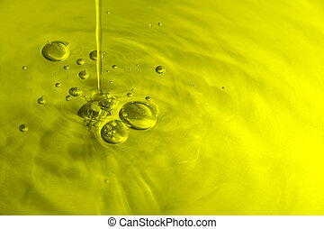 Olive Oil Bubbles - Yellow/green toned liquid with bubbles.