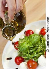 Olive Oil Dressing on Tomato Mozzarella Rocket & Basil Salad
