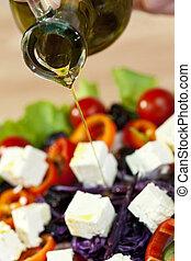Olive Oil Dressing Pouring Onto Fresh Salad