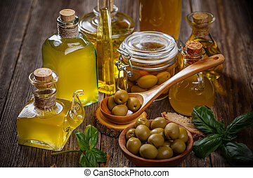 Olive oil glass bottles with olive berries