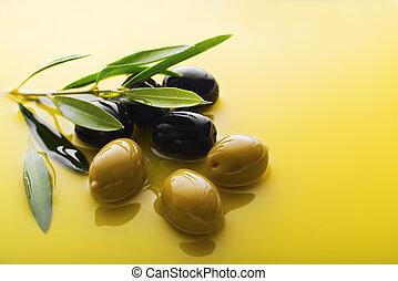 Olive oil - Olive fruit in oil background close up