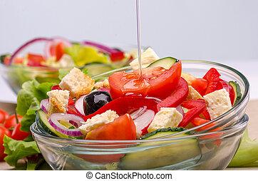 Olive oil on fresh salad