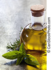 Olive Oil - Bottle of olive oil, with fresh basil and...