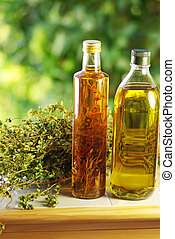 Olive oil, vinegar, and oregano herb.