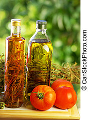 Olive oil, vinegar, oregano and tomato.