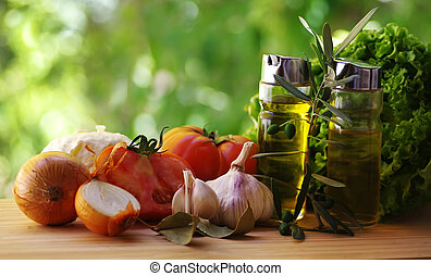 Olive oil, vinegar, tomato and herbs on rustic table