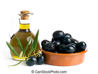 Olive oil with olives in a bowl