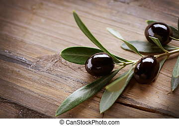 Olive over Wood Background
