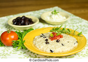 Olive risotto with tomato and herbs