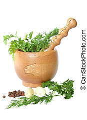 Olive tree mortar and pestle, greens, garlic and sweet peas on a white background