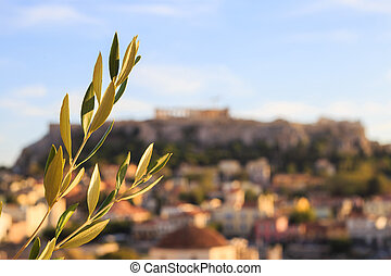 Olive twig on abstract Acropolis background. Athens, Greece.