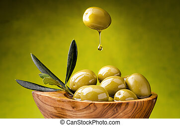 olive with drop of falling oil