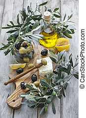 Olives an olive oil - Green and black olives with bottle of...