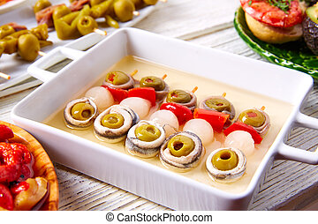 Olives anchovies and picked onion pinchos