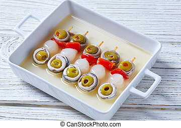 Olives anchovies and pickled onion pinchos