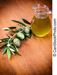 Olives and a bottle of olive oil isolated on wooden table